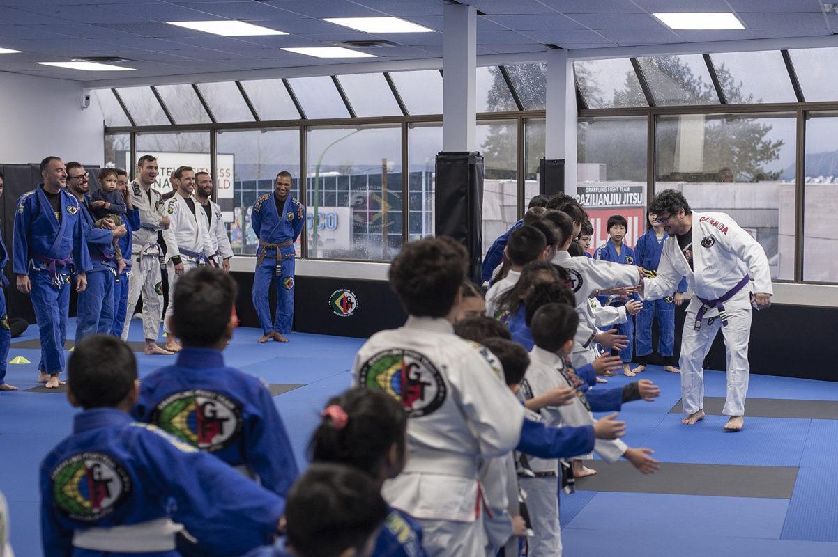 GFTeam Canada Brazilian Jiu Jitsu: John C high fives kids
